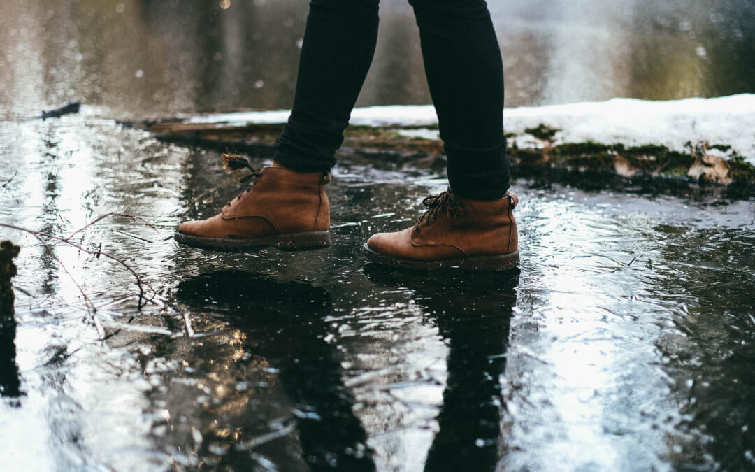 A person standing in the puddle