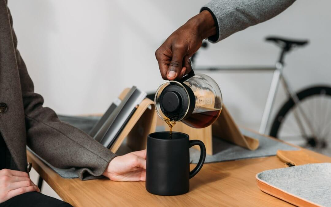 co-worker pouring coffee for another co-worker