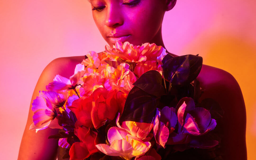 woman holding flowers with red lighting